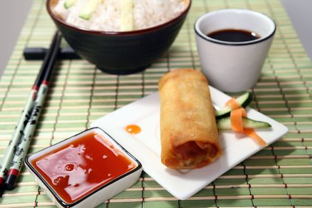 Crispy Chinese egg rolls with sweet and tangy chili sauce for dipping. Stock Photo - 809787