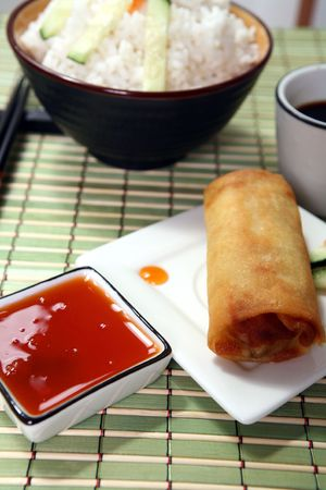 Crispy Chinese egg rolls with sweet and tangy chili sauce for dipping. Stock Photo - 809786