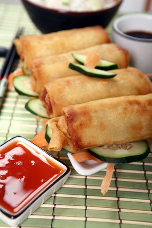 Crispy Chinese egg rolls with sweet and tangy chili sauce for dipping. Stock Photo - 809785