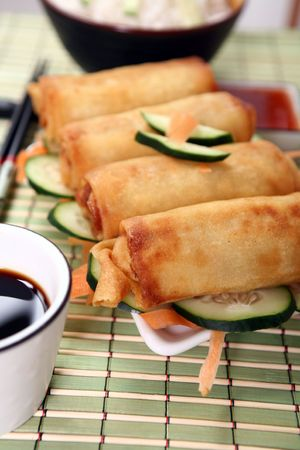 Crispy Chinese egg rolls with soya sauce for dipping. Stock Photo - 809784