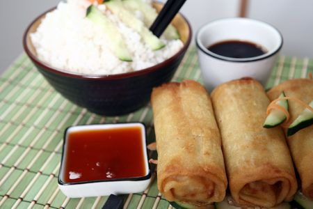 Crispy Chinese egg rolls with soya sauce for dipping. Stock Photo - 809781