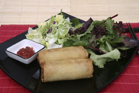 Crispy Chinese egg rolls with differents lettuce salad Stock Photo - 829981