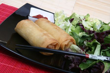 Crispy Chinese egg rolls with differents lettuce salad Stock Photo - 834997