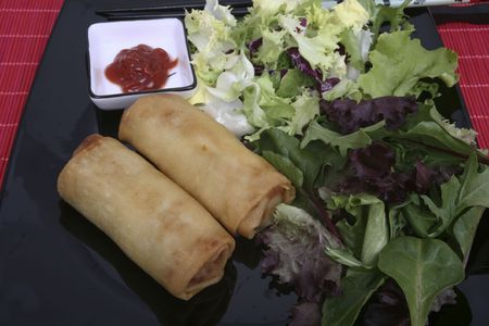 Crispy Chinese egg rolls with differents lettuce salad Stock Photo - 834996