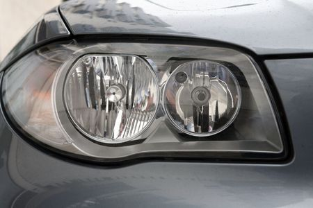 head lights of a sport grey car photo