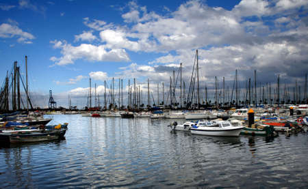 beatiful marina with lots of yatchs moored under cloudy sky Stock Photo