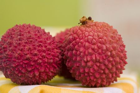 two exotic lychee fruits on decorated table