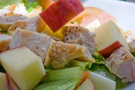 A healthy fast food salad with apple and grilled chicken photo