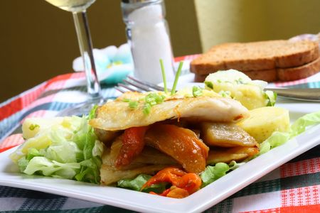 Grilled hake filet with roast pepper and aubergine on lettuce and potato salad Stock Photo - 934179