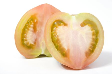 one tomato cutted with heart-shaped on white Stock Photo - 961472