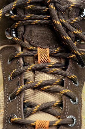 extreme close up of hiking boots shoelace