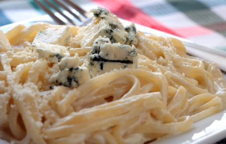 Plate of spaghetti with blue cheese sauce and a fork. Stock Photo - 1007291