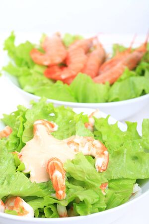 white bowl with prawns salad and mayonnaise sauce photo