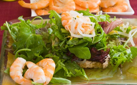 bread toast with assorted lettuce leaf and boiled prawn photo