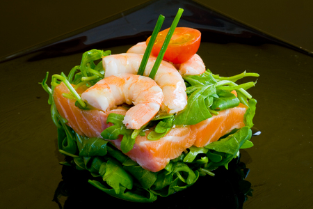 fresh salmon tartar on black platter with rocket salad Stock Photo - 1637422