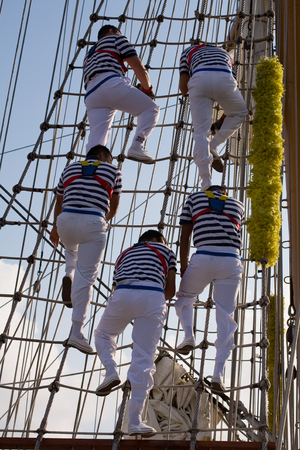 five young sailor climb on a school ship photo