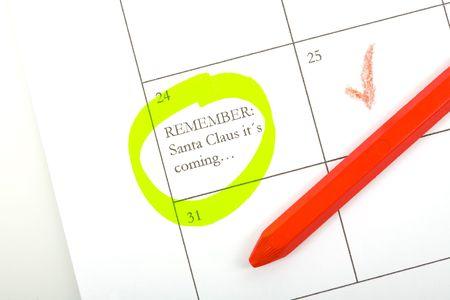 december calendar: dicembre calendario con nota post il 24 e penna rossa