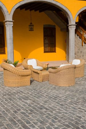 spanish village: spanish village outdoor terrace with wooden chairs