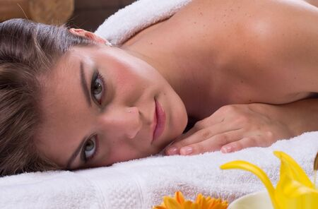 a beautiful woman relaxing in spa salon with flowers and candles Stock Photo - 1944356