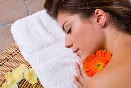 a beautiful woman relaxing in spa salon with flowers and candles Stock Photo - 1944366