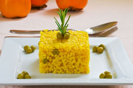 spanish and mediterranean yellow rice style on white platter Stock Photo