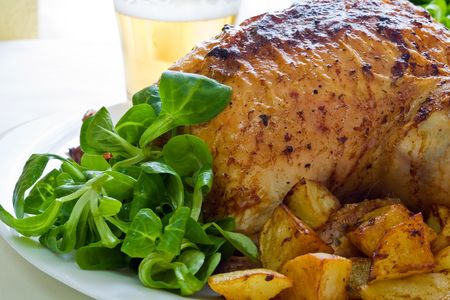 roasted chicken with potatoes and salad on white platter Stock Photo - 2180503