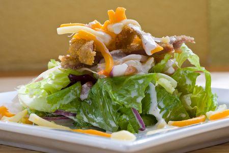 crunchy chicken cesar salad on white platter