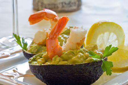 prawns and avocado salad served on white platter