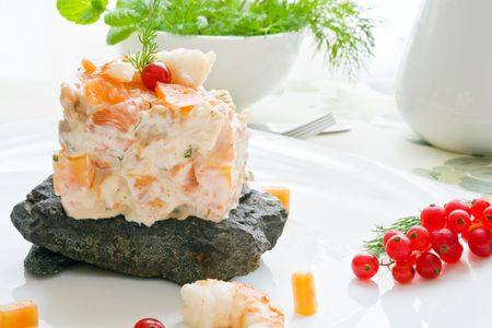 prawn and smoked salmon salad with dill sauce over black stone Stock Photo - 2361924