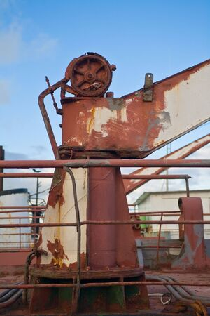 conduction: part of and old and dust oil ship in harbor