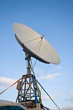 telecast: broadbrand satelite dish on blue sky background