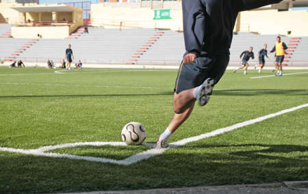 soccer or football player put the ball in the corner Stock Photo - 2476164