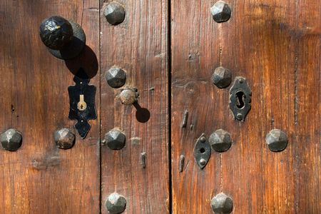 keylock: Old iron rust lock on brown wooden door