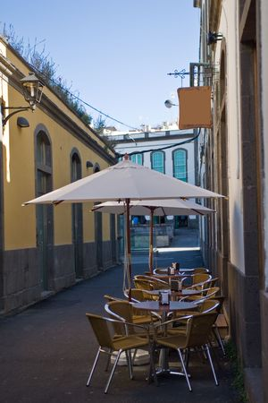 restaurant outdoor terrace with big white umbrella Stock Photo - 2577777