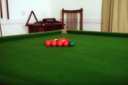 snooker rooms: preparing the billard ball on green table