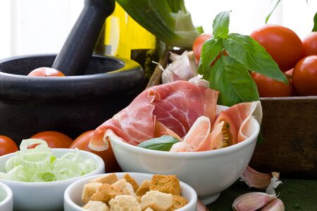 red cured ham and vegetables on white bowl photo