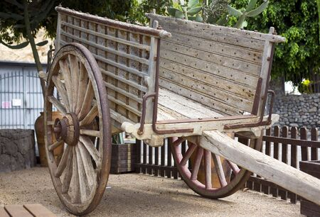 old wood farm wagon: antique wood cart with big wheels on park