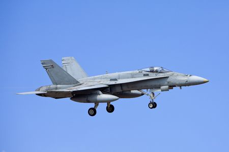 f18: F-18 Hornet army airplane with gear extended for landing Stock Photo