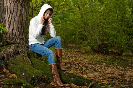 young woman on autumn forest under chestnut tree Stock Photo - 3690099