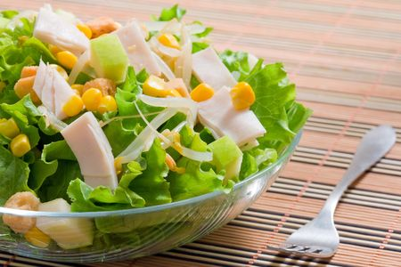 green salad: lettuce salad with sweet corn and turkey ham