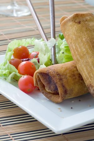 Crispy Chinese egg rolls with lettuce and tomato Stock Photo - 3738251