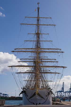 brigg: front view of a tall ship under blue sky
