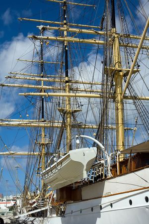 brigg: lateral view of a tall ship under blue sky Stock Photo