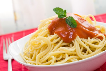 spaghetti with tomato sauce on white bowl and fork Stock Photo - 3990873
