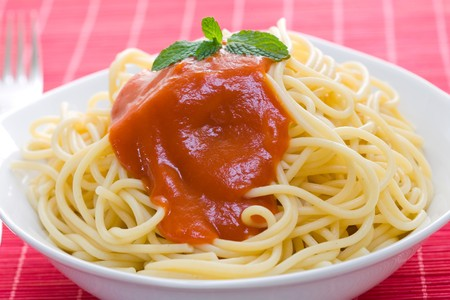 spaghetti with tomato sauce on white bowl and fork Stock Photo - 3990871