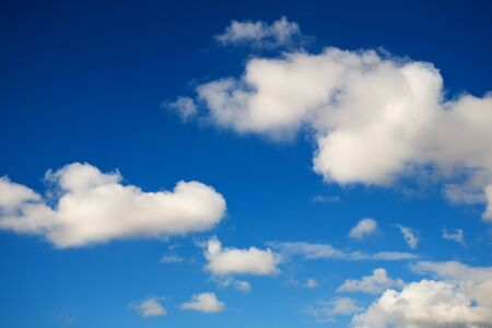 puffy: Puffy white clouds in a blue sky day  Stock Photo
