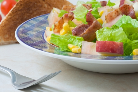 croutons: bacon and red apple salad with bread croutons and fork Stock Photo