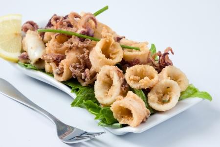 tast: deep fried calamari with letucce and lemon