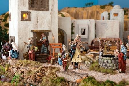 Nativity scene from figurine crib like an old Jerusalem village