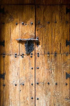 an old iron metal door handle knocker and locker photo